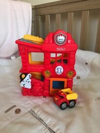Fisher price small noise garage with car.