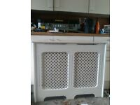 White radiator cover with patterned front