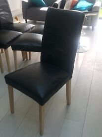 FREE: 8 well used black leather dining chairs