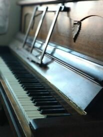 Old fashioned upright piano for sale
