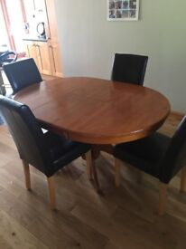 Extendable dining room table and 3 chairs.