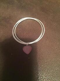 Silver bracelet with pink heart charm