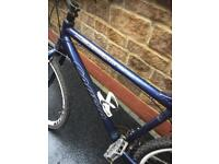 Carrera subway limited blues men's hybrid bike