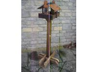 Bird feeding table on self supporting stand.