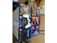 PlayStation 4 with games.