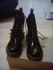 Ladies Doc Marten boots black patent leather size 5 brand new not worn still in the box.