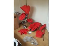 Stokke Xplory travel system in red