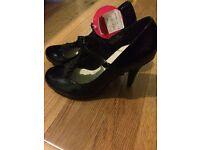 Shiny Black, brand new, size 5 high heeled shoes