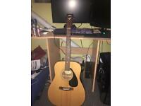 Yamaha f310 guitar, padded case and beginner books