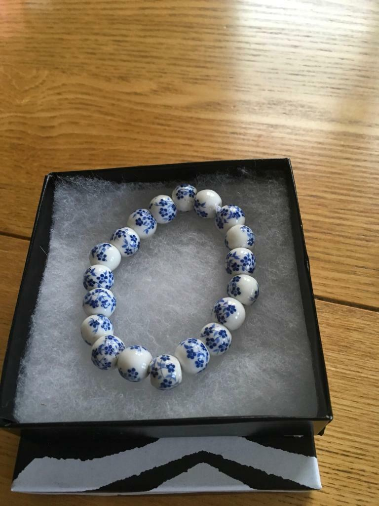 Ladies bracelet with blue and white porcelain balls free size new