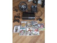 playstation 3 with 2 wireless controllers and 8 games