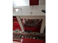 White next extending table and 4 red leather effect chairs