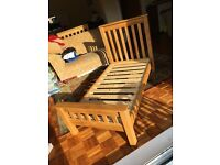 Solid oak cot bed. Used in immaculate condition. Would suit birth -4 years old.