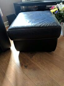 Single brown leather chair and pouffe