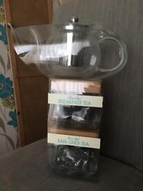 Tea pot and loose tea set
