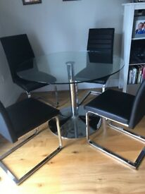 Harvey's 110cm diameter glass table + 4 chairs Chrome finish hardly used collection by the buyer