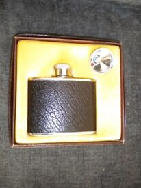 A WHISKY FLASK AND FUNNEL IN PRESENTATION BOX