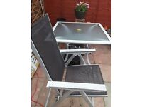 Patio table with glass top and 4 high back chairs