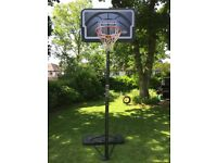 Portable basketball net with adjustable height pole
