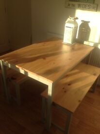 Dining Table and two benches .