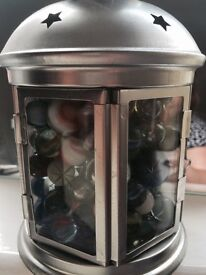 Marbles stored in a lantern , makes an interesting gift