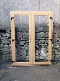 Eurocell French doors - wood effect both sides.