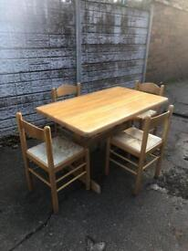 Used condition solid pine table + 4 chairs only £35