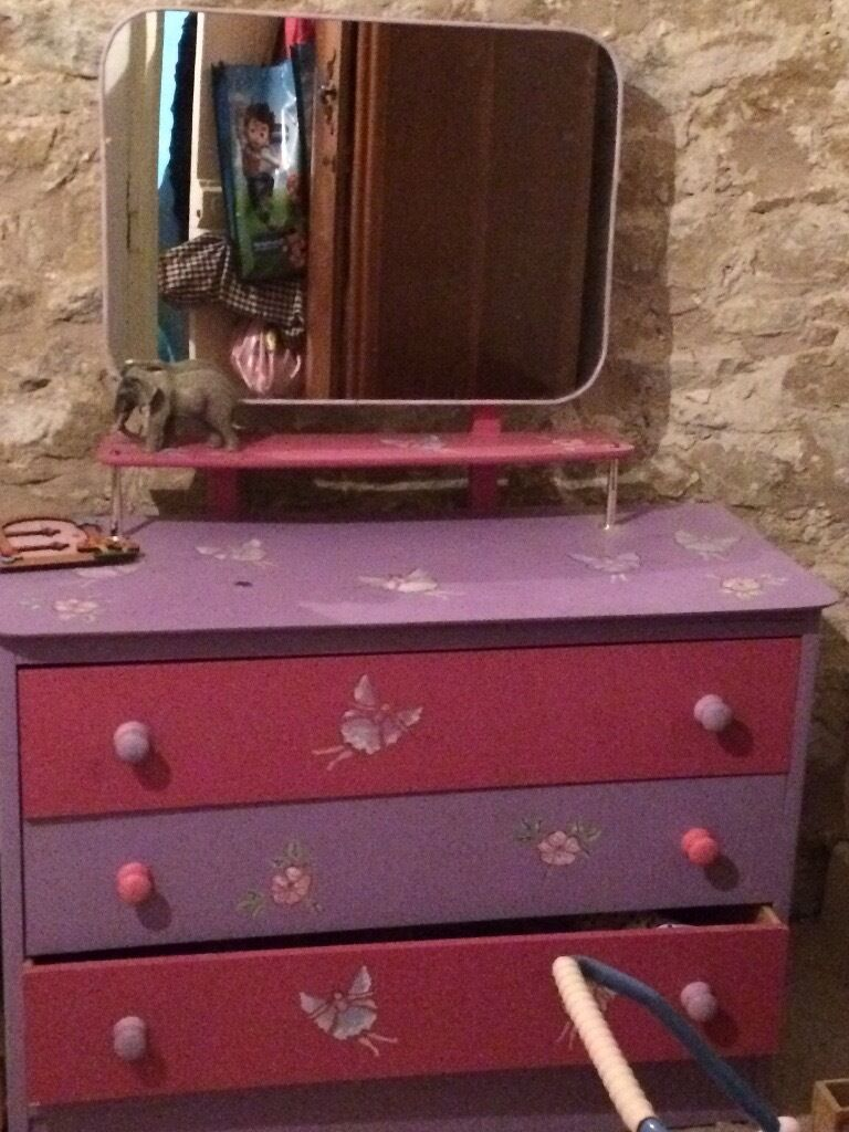 Chest of drawers with mirror. Handpainted and stencilled in purple and pinkin Holywell, FlintshireGumtree - Chest of drawers / dressing table. Hand painted and stencilled with fairies. Purple and pink. Mirror and shelf with 3 drawers. In good condition. Bottom drawer needs a simple repair. Collection from Rhes y Cae