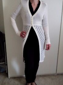Nice long crochet style cardigan. Fit size 10/12. Not been worn. £6.
