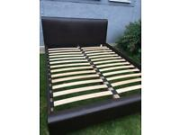 Lovely Julian Bowen double size bed frame, excellent condition, 4ft6, faux brown leather