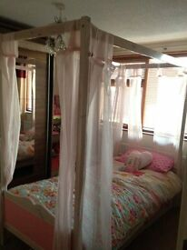 Single four poster bed with matching furniture
