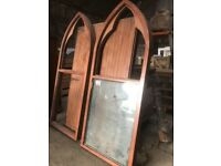 Two large Gothic style mahogany window frames