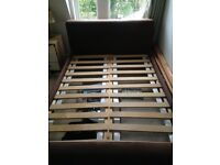 Stylish suede/wood double Bed. Good Condition.