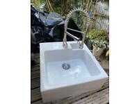 Designer tap and ceramic Butler's kitchen sink