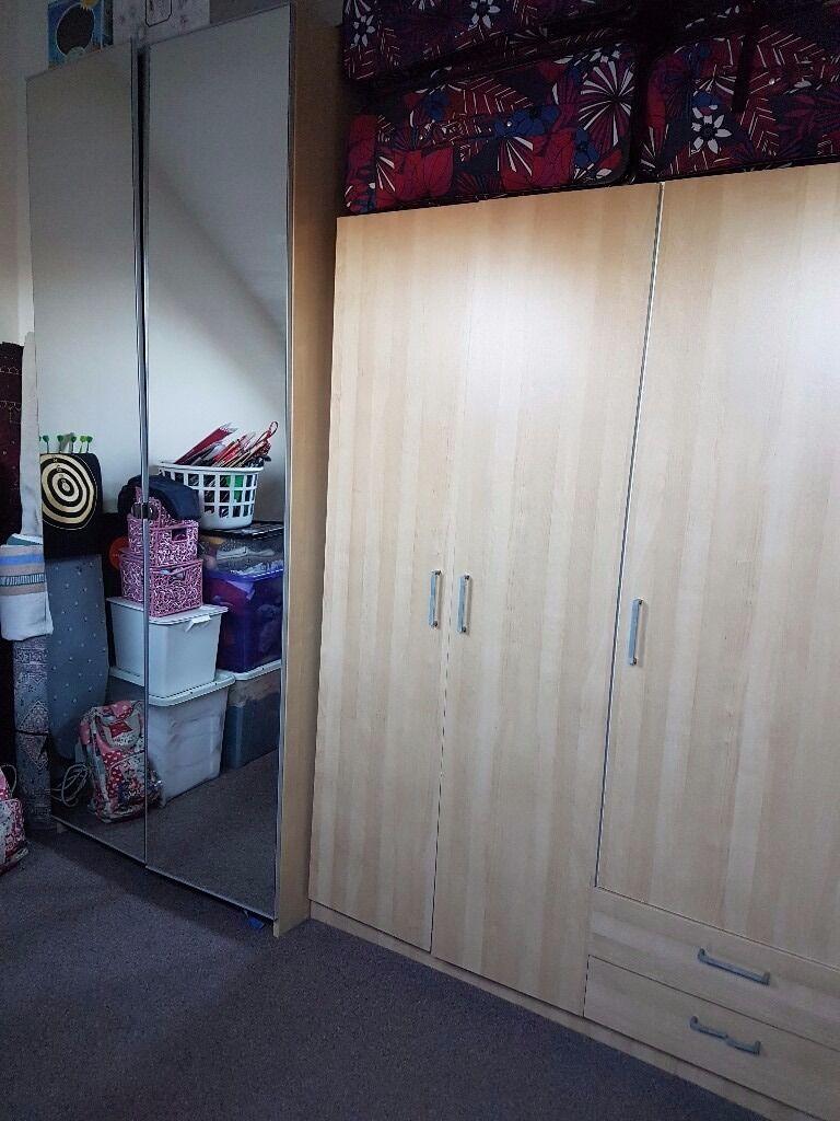 A tall mirrowed door wardrobe from ikea (£35)