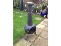 Metal chimenea. In good condition. For use as a patio heater or cooking or burning wood or paper.