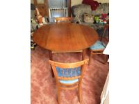 Retro dining room table with four  chairs