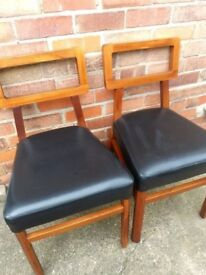 2 × Dark Wooden and Black Faux Leather seat chairs