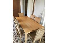 Dining table and 6 wicker chairs for sale