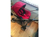 Red silver cross freeway pram with car seat