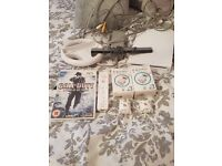 Wii console with call of duty game 1 controller 4 motion plus and a steering wheel