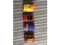 Four Vtech Toot Toot vehicles