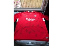 This is a 2005 signed liverpool shirt includes: steven gerrard, jamie carragher