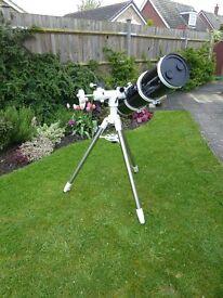 Astronomical Skywatcher PDS 8 inch reflectiong telescope on a Skywatcher Sky T manual tripod