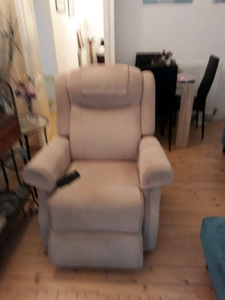 Mobility rise and relax beautiful recliner. In beige patterned velour.