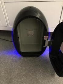 Black egg shaped mini fridge
