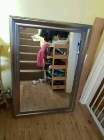 Silver framed rectangular mirror