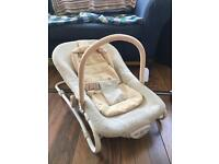 Cream Cosatto baby bouncer with sound and vibration