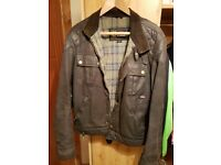 Steve McQueen replica 1964 waxed cotton blouson jacket. Some repairs but good condition. Rare item