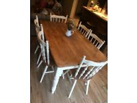 Oak dining table and six matching chairs